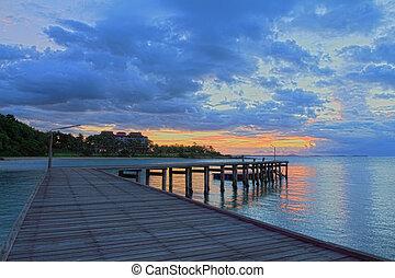 Wood bridge path at beach sunrise