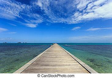 Wood bridge to the sea in Koh Samui, Thailand
