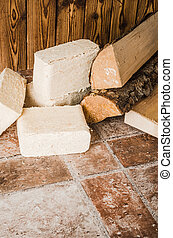 Wood briquette and firewood, close-up