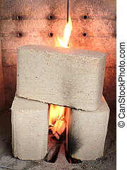Wood briquettes burning in stove