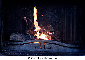 Wood burning in a cozy fireplace at home. fire burns in the fireplace. Winter and Christmas holidays concept.