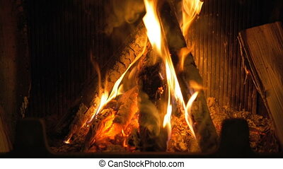 Wood burning in the fireplace.