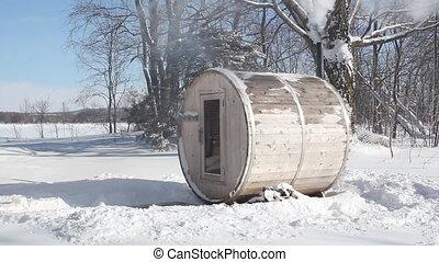 Wood-burning sauna. 2 shots. - Small wood burning sauna with...