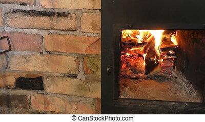 Wood burning stove - Man hand opens wood burning stove hatch...
