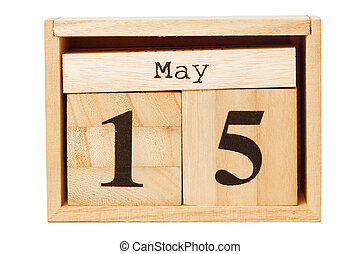 wood calendar isolated on white background. creative photo.