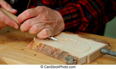 Wood carving artist at work