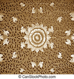 Wood carving brown floral pattern background texture.