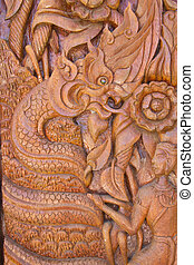 Wood carving decorated at windows of the temple, hand made by Th