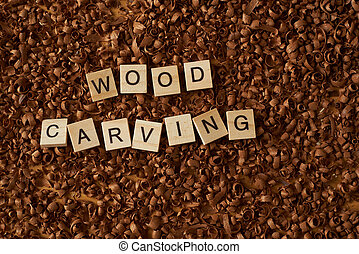 wood carving word writen with letters on a wood chips