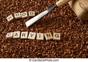 wood carving word writen with letters on wood chips with chisel and mallet