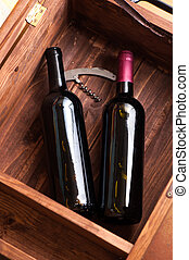Wood case with bottles of wine - Open wood case with two...