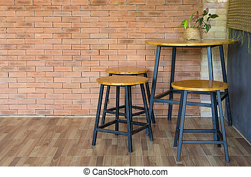 wood chair and table on brick wall