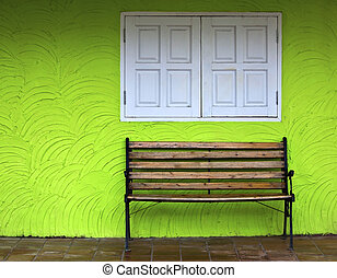 Wood chair on green wall background