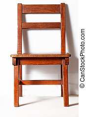 wood chair with white wall in background