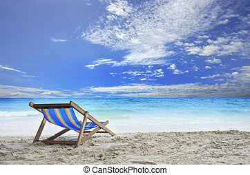 wood chairs deck on white sand beach with clear blue sea water and cloudy sky use for natural haliday vacation destination