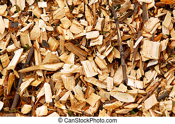 Wood chips - Background of freshly made yellow wood chips