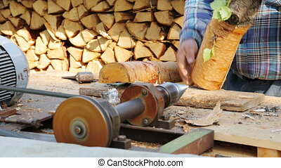 Wood chopping fresh birch logs
