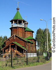 Wood church - Wood Russian church on a background of blue...