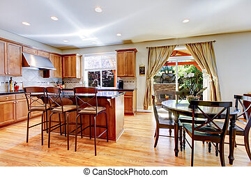Wood classic large kitchen with granite island.