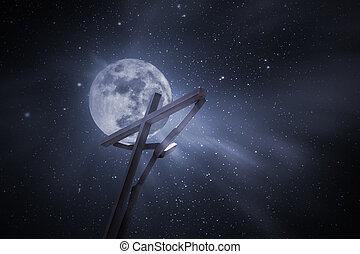 Wood cross in a full moon night