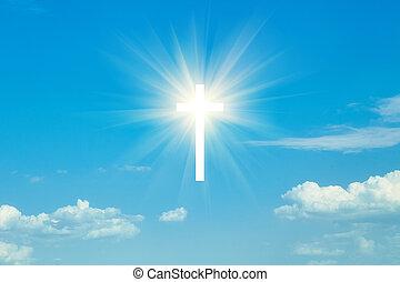 wood cross on blue sky