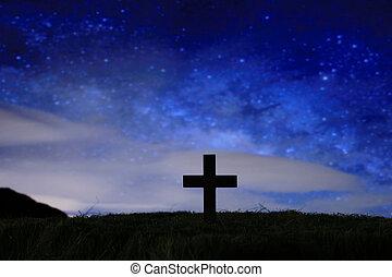 wood cross over a dark night starry sky