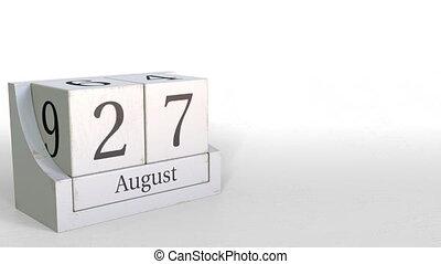 Wood cube calendar shows August 27 date, 3D animation -...