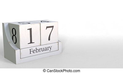 Wood cube calendar shows February 17 date, 3D animation - ...