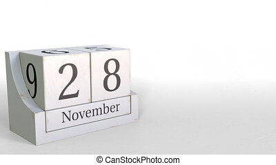 Wood cube calendar shows November 28 date, 3D animation -...