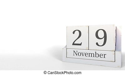 Wood cube calendar shows November 29 date, 3D animation -...