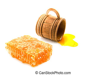 honey - wood cup and honeycomb isolated