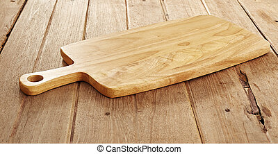 Wood cutting board on wooden background