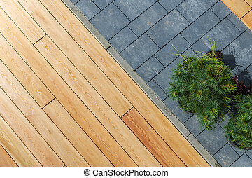 Wood Deck and Concrete Bricks Pavement in a Garden