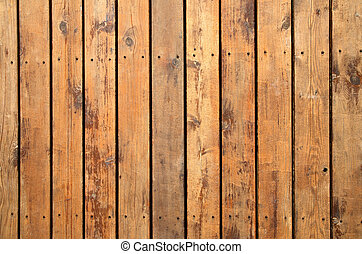 Close up of weathered wooden garden decking.
