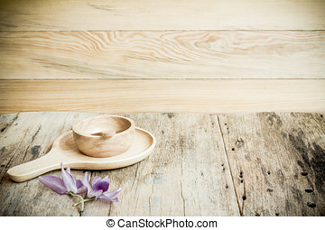 Wood dish on the wooden background.