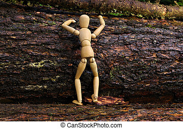 Wood doll climbing a tree