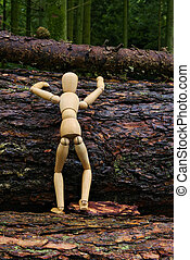 Wood doll climbing a tree