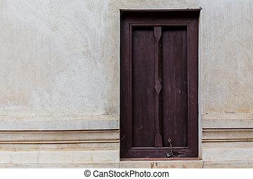 wood door on old brick wall