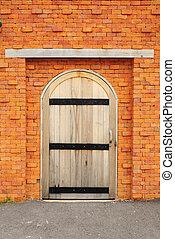 Wood door on orange brick wall