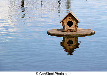 Duck house on the lake. photo