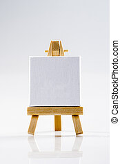 Wood easel, white canvas