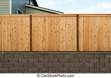 Wood Fenceing over Stone Retaining Wall