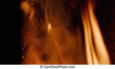 wood firewood burns close up.