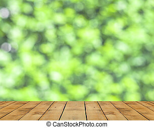 Wood floor and spring green bokeh background