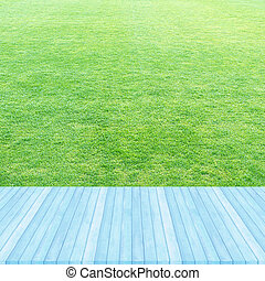 Wood floor blue pastel colour perspective on fresh spring green grass