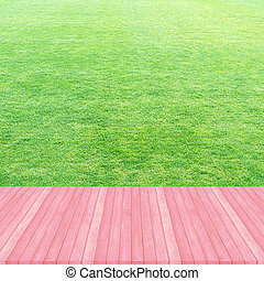Wood floor pink pastel colour perspective on fresh spring green grass