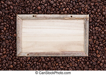 wood frame on top of flat lay of brown roasted coffee bean can be used as a background