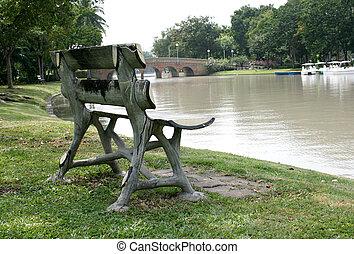 wood garden chair on green grass