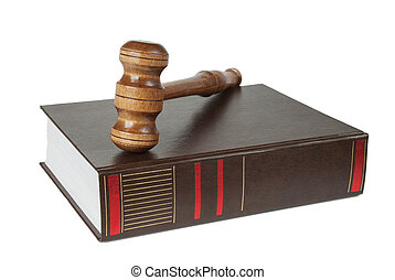 Wood gavel and soundblock on on a thick book isolated on...