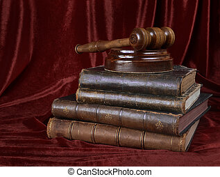 Wood gavel and stack of old books